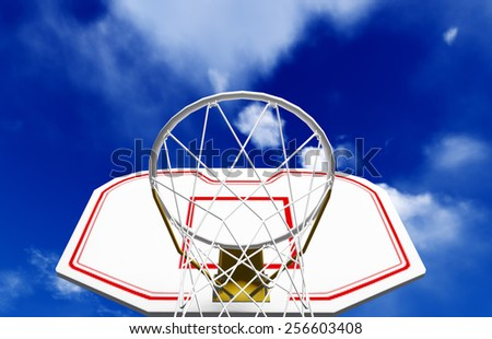 Basketball hoop isolated on blue sky - stock photo