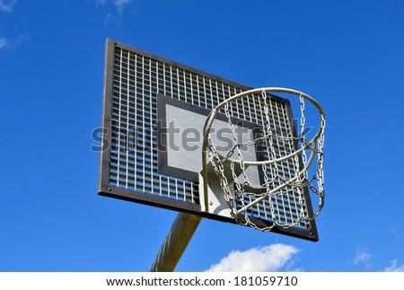 Basketball hoop, streetball rim against blue sky. - stock photo