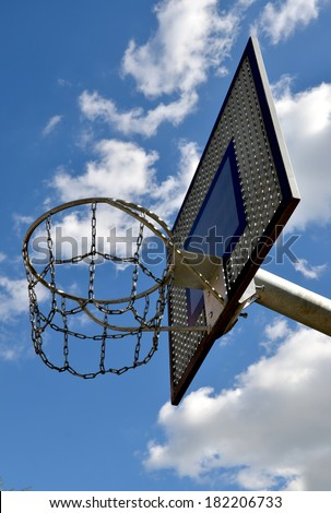 Basketball hoop, streetball rim against blue sky.