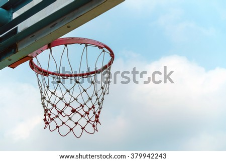 Basketball hoop with beautiful blue sky and cloud