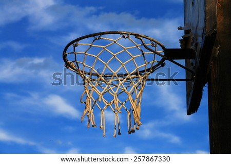 Basketball hoop with cloudy blue sky  - stock photo