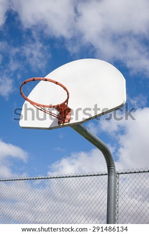Basketball hoop without net and sky.
