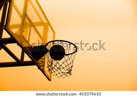 Basketball in a net - stock photo