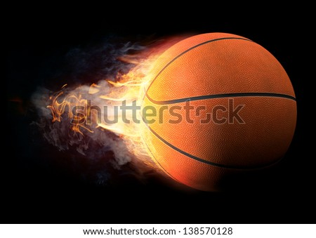 Basketball in Fire on black background - stock photo
