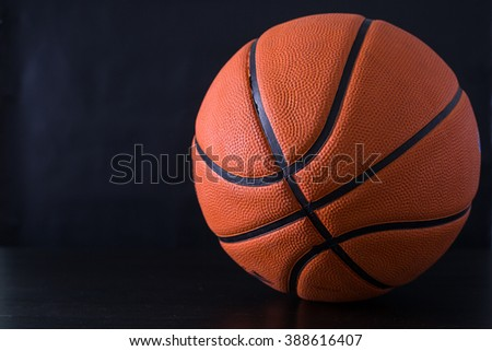 Basketball item ball with black background.