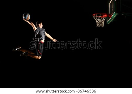 Basketball jump isolated on black background - stock photo