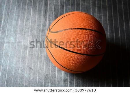 basketball on a black floor - stock photo