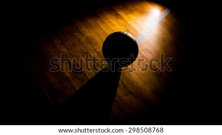 Basketball on court with light effect  - stock photo