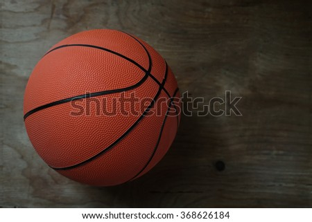 Basketball on old wood table                   - stock photo