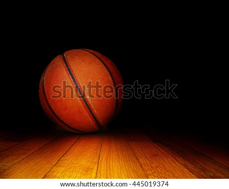 basketball on the court, over dark background
