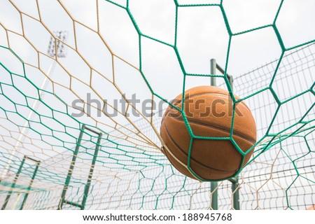 Basketball on the net - stock photo