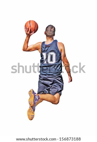 basketball player about to dunk - stock photo