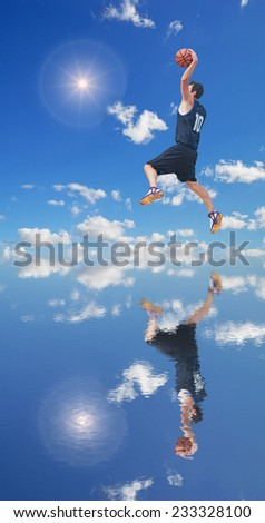 basketball player dunking in the sun reflected in the water - stock photo