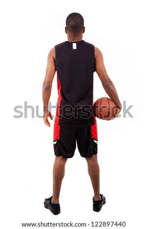 Basketball player from back, isolated in white background - stock photo