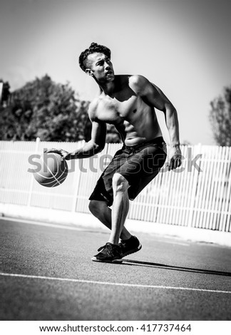 basketball player in action. Black and white - stock photo
