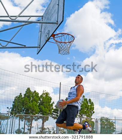 basketball player jumping in the air - stock photo