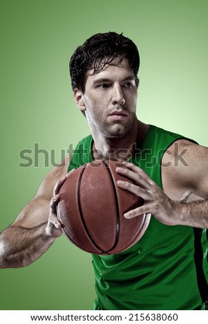 Basketball player on a  green uniform, on a green background.