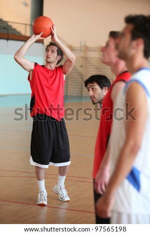 Basketball player shooting - stock photo