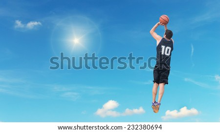 basketball player shooting in the sky - stock photo