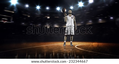 Basketball player spinning ball in gym  panorama view