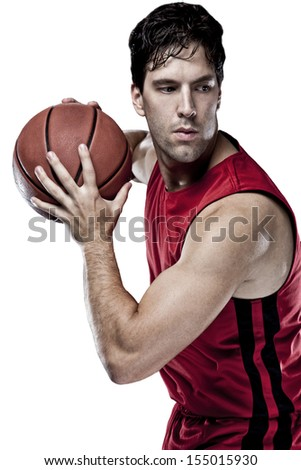 Basketball player with a ball in his hands and a red uniform. On a white Background - stock photo