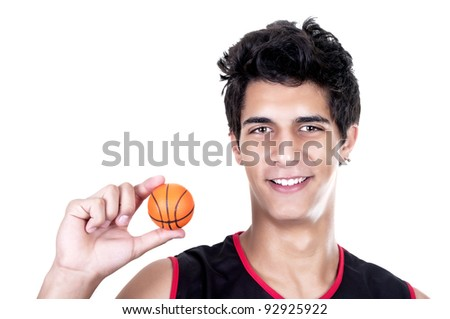 basketball player with miniature ball on white background