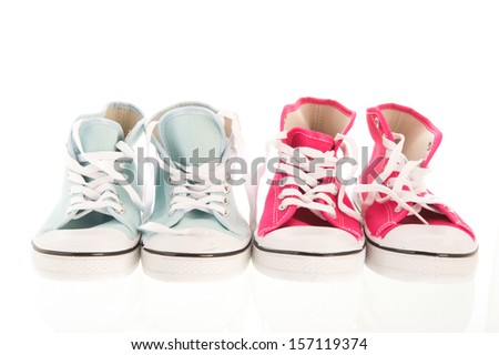 Basketball shoes in pink and blue - stock photo
