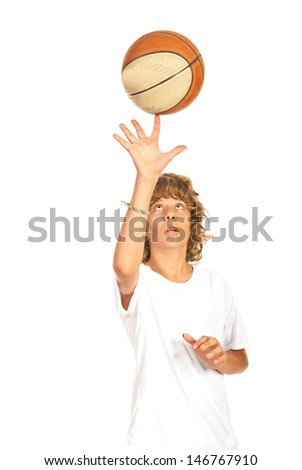 Basketball teen boy player spinning ball on his finger isolated on white background - stock photo