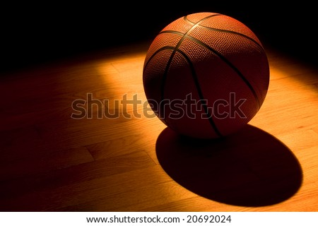 Basketball under the spotlight - stock photo