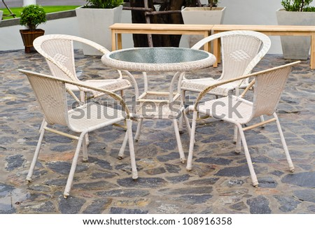 basketry chairs set on the slate stone decorative floor. - stock photo