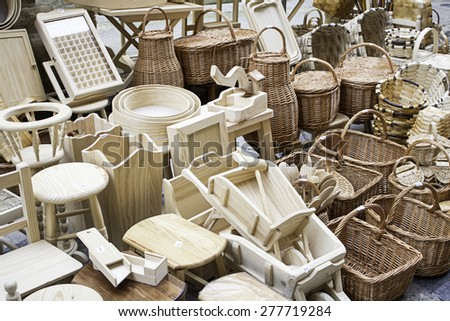 Baskets and wicker chairs crafts market - stock photo