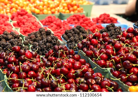 Baskets of berries in a market - stock photo