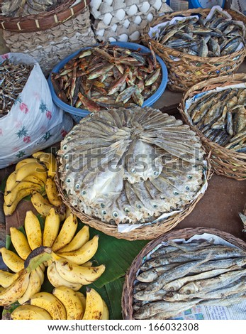 Baskets of dried, salted fish for sale at a market in Bogo City, Cebu Island, Philippines. - stock photo