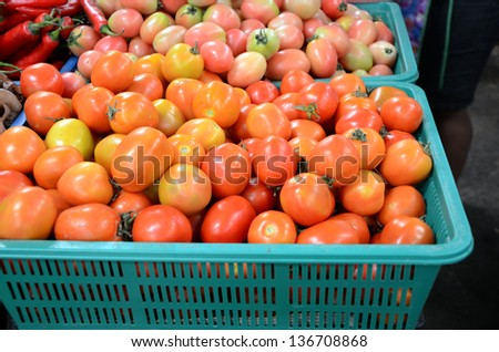 Baskets of tomatoes for sale at a farmer's market. - stock photo