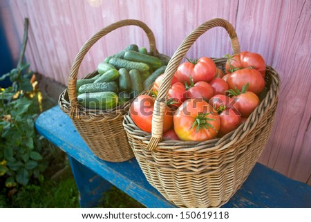 baskets with cucumbers and tomatoes