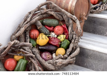Baskets with fresh vegetables and fruits in Fira, Santorini, Greece