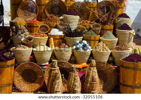 Baskets with spicery on east bazaar - stock photo
