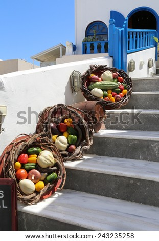 Baskets with vegetables on a stair in Greece - stock photo
