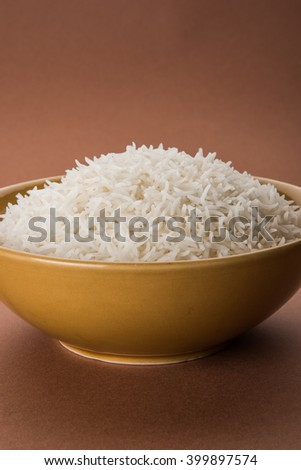 basmati rice in a ceramic yellow bowl, indian basmati rice cooked and served in a ceramic bowl