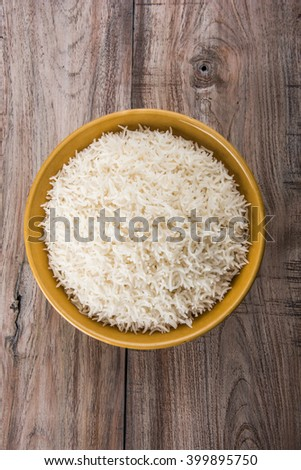 basmati rice in a ceramic yellow bowl, indian basmati rice or basamati rice cooked and served in a ceramic bowl