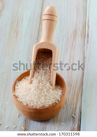 Basmati rice  on a wooden table. Selective focus