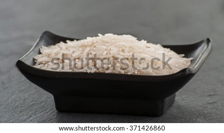 Basmati rice on black background