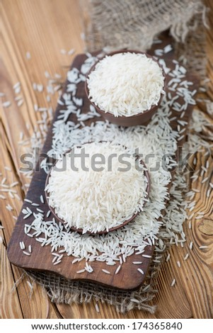 Basmati rice, rustic wooden background, above view - stock photo