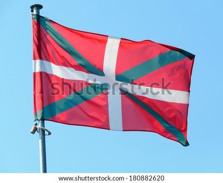 Basque country flag, blue sky background - stock photo