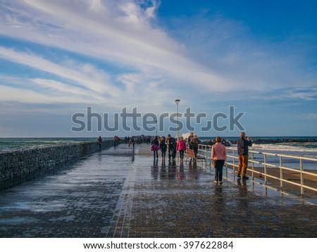 Basque country, Sant Sebastian, waves on street - stock photo
