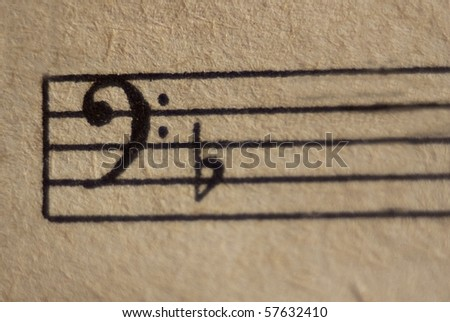 Bass clef with flat on a stave close up