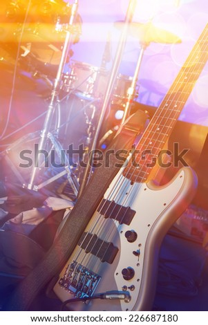 Bass guitar and drums on stage before concert  - stock photo