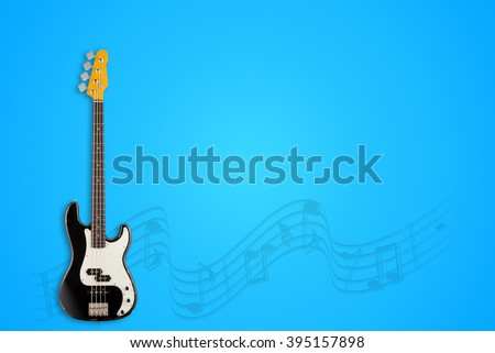 Bass Guitar and notes on blue background - stock photo