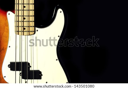 bass guitar. black background.close-up.musical instrument - stock photo
