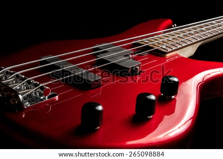 Bass guitar close-up. Photo in low key - stock photo